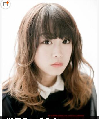 蓬松的烫发展现搭配上可爱的齐刘海,不仅修颜,而且也齐肩出甜美轻盈的李小鵬发型图片