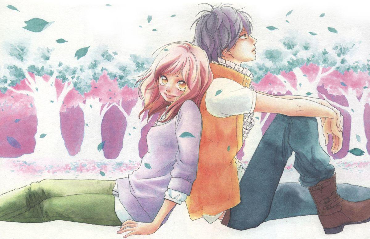 夏日里,两个人依偎在一起,坐在草坪上.