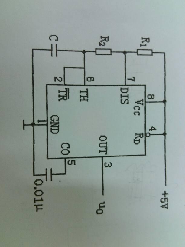 下图为由555定时器连成的电路图,请说明电路的功能,写出电路频率