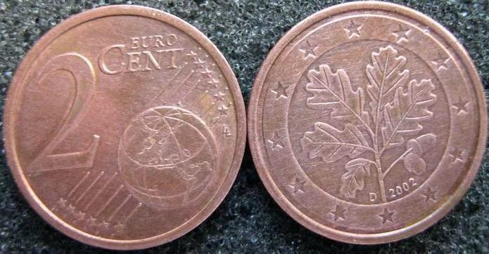 硬币背面是一片橡树叶,正面则是地球图案与面额(看不到正面,该枚硬币图片