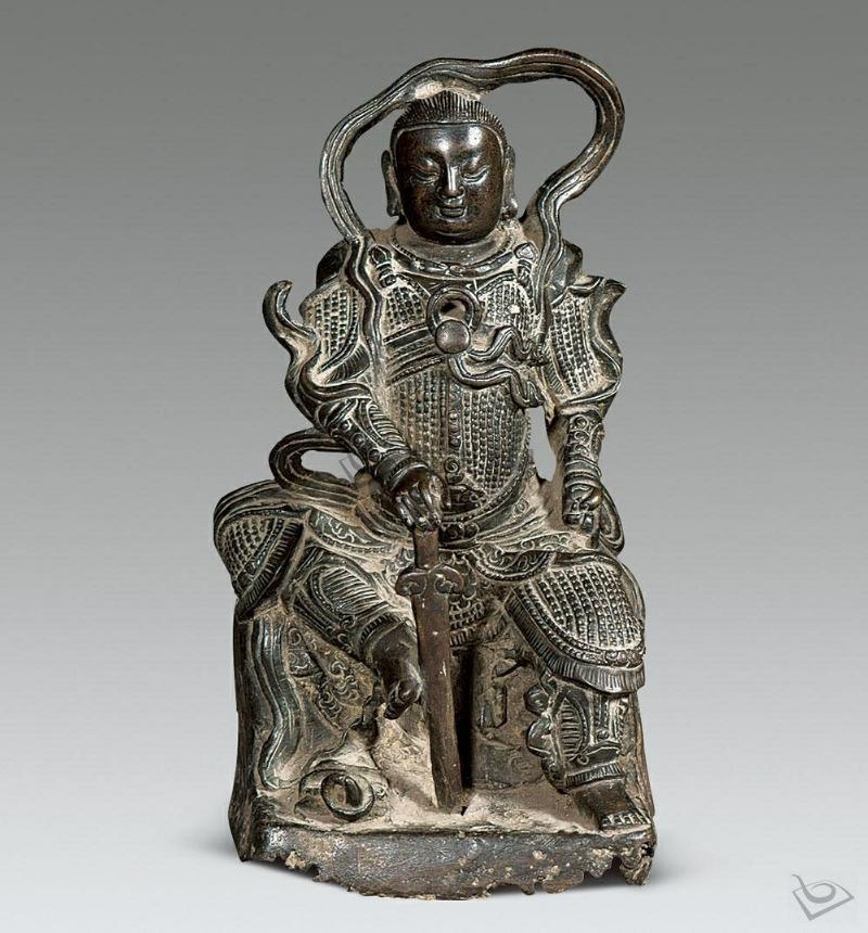 你去看看明代真武大帝铜像 现在有很多的照片 各种形制 没见过这种图片