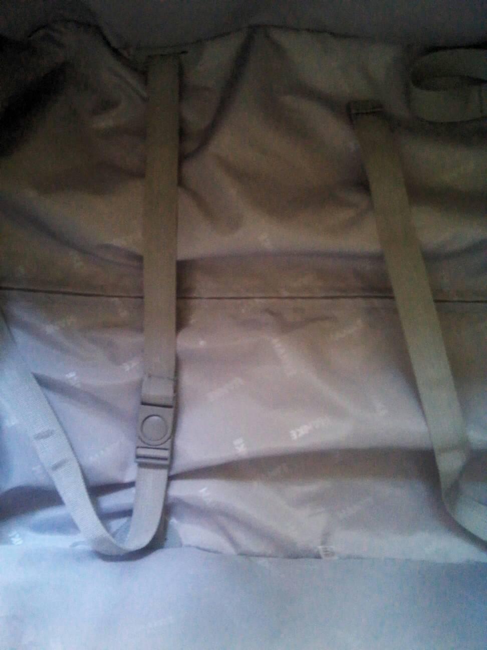 行李箱里的这两条带子是干什么用的?