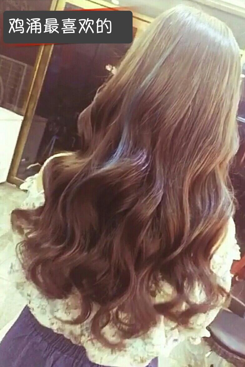 这样的头发是用卷发棒烫的,差不多是一次性的.图片