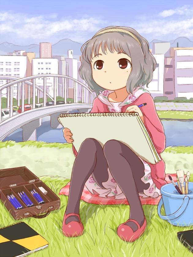 正在画画的动漫少女图