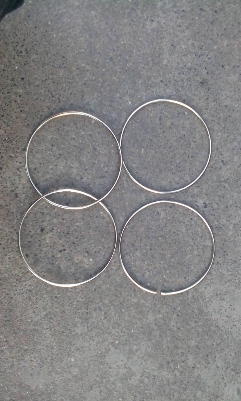 这个铁环魔术帅是怎么做的,是不是被骗了,有两个环永远打不开, 最好友