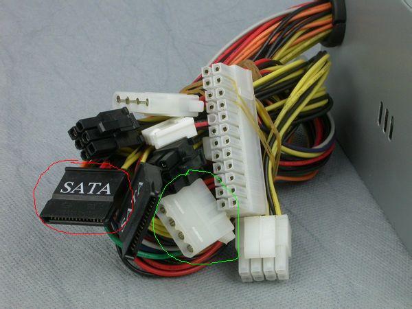 你手上拿的线应该接到电源的sata串口硬盘电源线上图片