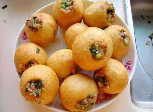 外面圆球形状可以食用,里面可以塞肉馅叫什么来着,在上海吃过,不记得