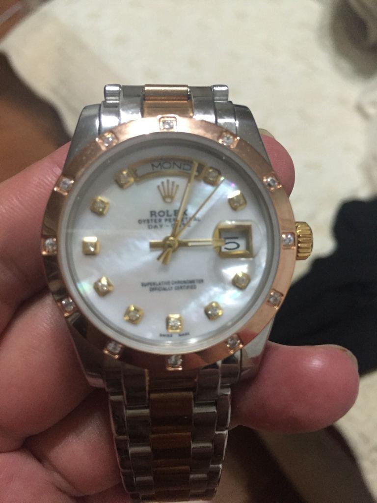 朋友送的特别老款劳力士手表,帮忙鉴定一下真假图片