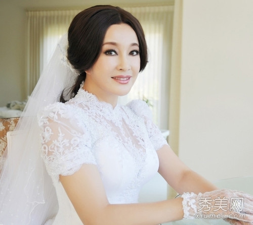 58岁刘晓庆自称未整容 不老童颜只靠PS