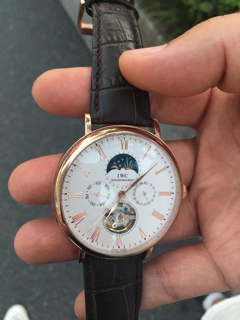 誰知道這款iwc/萬國手表是什么型號,價錢是多少啊?怎么樣鑒別真假!圖片