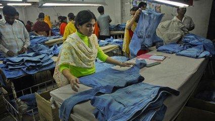 服装厂包装工图片_服装厂里包装工是干什么的,累不。_百度知道