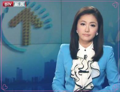 范奕_军情解码的女主持人范奕漂亮吗,谁有她的图片_百度知道
